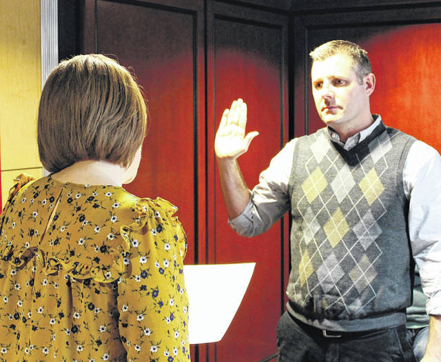 Arcanum Village Solicitor Nicole Pohlman swears in Greg Baumle as Arcanum mayor Tuesday. Baumle replaces outgoing Mayor Judith Foureman, who offered her resignation with one year remaining in her term.