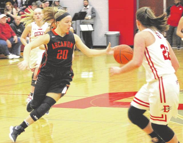Arcanum's Kayla O'Daniel cuts through the Dixie defense on Monday night in a non-conference contest at Dixie. The Trojans defeated the Greyhounds, 74-24.