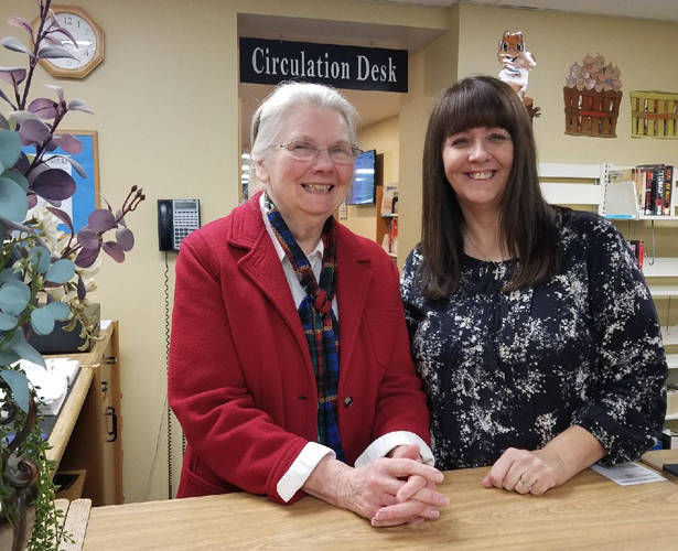 The Greenville Public Library will no longer charge patrons for overdue items. Pictured are librarians Elois Hatfield and Beth Womboldt.