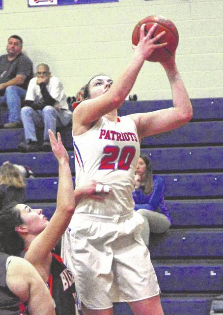 Tri-Village's Meghan Downing goes in for a score in a game earlier this season. The Lady Patriots have moved up one spot to fourth in the latest Division IV state basketball poll.