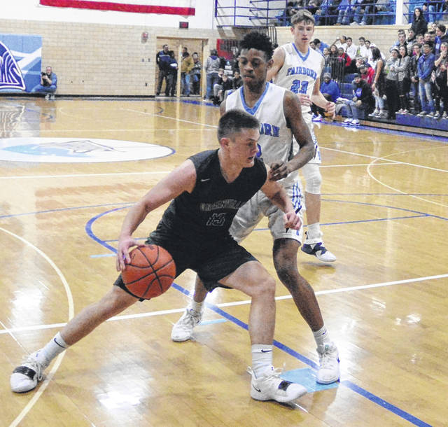 Greenville's Noah Walker tries to get around a Fairborn defender during their Greater Western Ohio Conference game on Friday night. The Skyhawks won the game, 83-30.