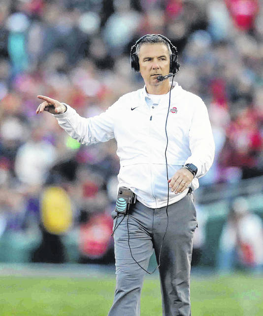 Ohio State head coach Urban Meyer, coaching his final game for the Buckeyes, watches the action during the second quarter during the 105th Rose Bowl game Tuesday.