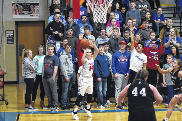 Emma Printz shoots a 3-pointer from in front of the Tri-Village student section during a huge Cross County Conference battle with Covington on Thursday night. The Patriots won the game, 44-35, to remain as the only undefeated team in conference play.