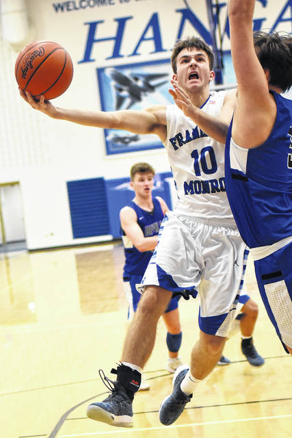 Franklin-Monroe's Jordan Rhoades throws up a right-handed hook shot against Brookville on Saturday in the championship game of the Jet Holiday Tournament. The Blue Devils won the game and the tournament by a score of 73-58.