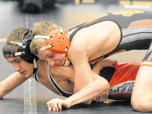Versailles' Trevor Huber controls Jeremy Surgeon of Bluffton in a 113-pound match on Jan. 24, 2018. The Versailles sophomore died following an all-terrain vehicle accident.