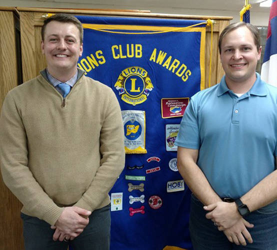 North Side Elementary Assistant Principal Andy Stover and Lion Blake Clevenger are pictured at the Union City Lions Club's meeting on Tuesday.