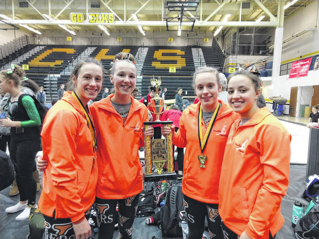 The Versailles gymnastics team finished in second place at the Centerville meet on Saturday. Pictured left to right with their runner-up trophy are Jadyn Barga, Jayla Pothast, Madison Ahrens and Ellie Barga.