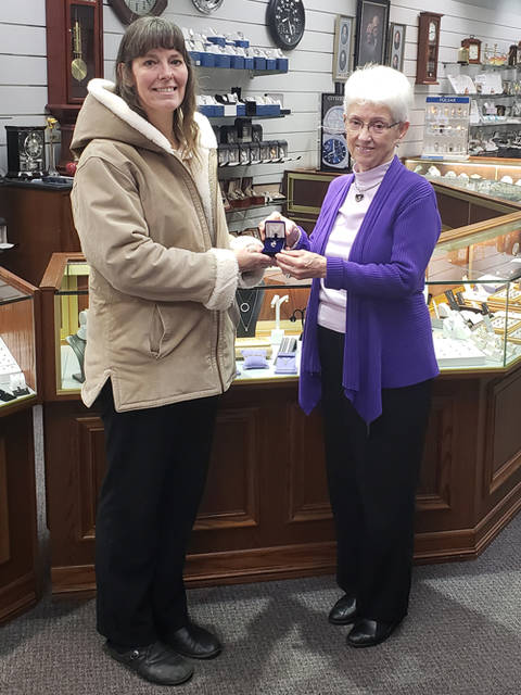 Arlene Bankson (right) of Weiland Jewelers presents a pendant necklace to Angela Coppess, a winner in The Daily Advocate's 12 Days of Giving.