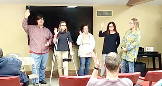 Edison State students and members of the audience raise their hands to indicate they had been victims of bullying during their lives. Pictured (l-r) are Edison State team members at the Greenville Public Library, Christopher Bucklew, Baylee Petry, Renee Netzley, Hope Byrum and Dawn Cleere.