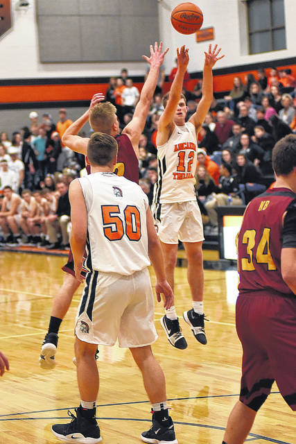 On this shot, Arcanum junior Carter Gray joined the 1,000-point club. His 17 points for the game helped lead the Trojans to a 64-56 win over New Bremen on Saturday in the final game of the regular season.