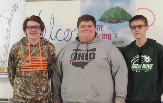 Greenville High School students Nicholas Colby, Aaron Buchy and Matthew Karns won first place at Friday's competition. Their structure held 5.7 pounds.
