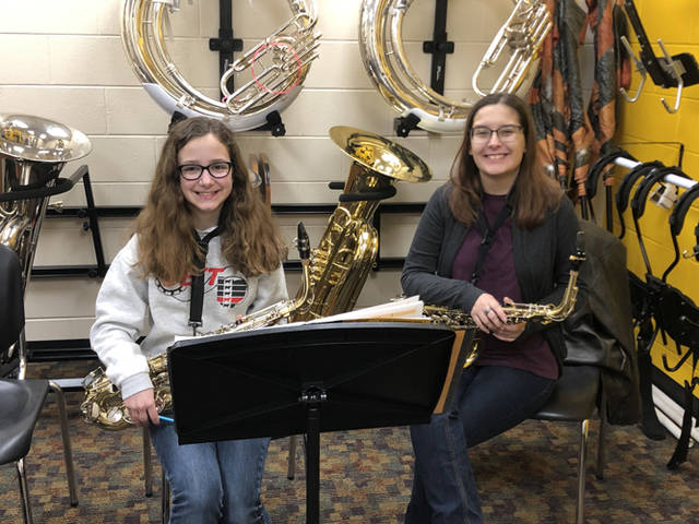 Senior saxophonist McKayla Hess and fifth grader Paige Gehret are pictured during a morning alto sax lesson.