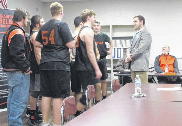 Sam Wildow | Miami Valley Today Robert Price of Union speaks with members of the Bradford varsity football team during the Bradford Board of Education's special meeting on Monday evening.