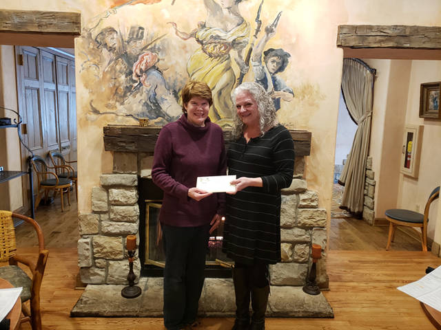 Carol Holmes of Greenville (left) receives the grand prize Valentine's Day Sweepstakes package from Telissa Delligatta, general manager of the Inn at Versailles. Holmes won a Sweetheart Package from the Inn at Versailles, which includes one-night stay in one of the premium rooms, a bottle of champagne, a box of Ghyslain Chocolates, a sweetheart rose and a $50 gift card toward dinner at Michael Anthony's.
