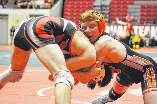 Versailles freshman Carson Bey wrestles at 132 pounds in the Tigers quarterfinals match against Mantua Crestwood on Sunday in the State Dual Team tournament at St. John Arena.