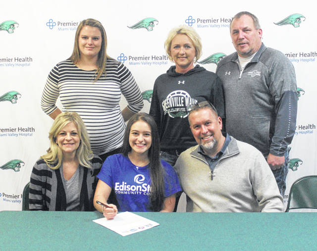 Greenville senior Chloe Cox (seated center) signed with Edison State Community College recently to continue her volleyball career. Cox is pictured sitting at the table with her parents Michelle and Aaron Cox. Standing in the back are EDCC volleyball coach Julia Brandewie and Greenville coaches Michele and Jim Hardesty.