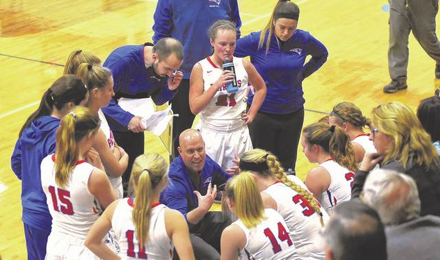 Tri-Village girls basketball coach Brad Gray talks to his team during a time out in a recent game. The Lady Patriots earned the No. 1 seed in the Division IV Brookville sectional tournament at Sunday's tournament draw meeting.