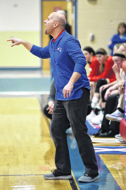Tri-Village coach Brad Gray guided his team to a perfect 12-0 record in the Cross County Conference this season earning the Coach of the Year honors.