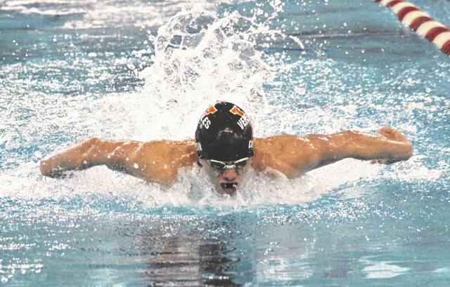 Versailles senior Cole Condon competes in the 100-yard butterfly on Friday in the Division II boys district swim championships at Miami University in Oxford. Condon qualified for the state meet in the 100 fly and the 50 free.