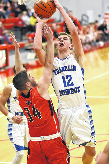 Franklin-Monroe's Connor Crist goes in for a score against Cedarville in a Division II sectional semifinal on Tuesday at Troy. Crist had a game-high 18 points as the Jets won the game, 54-38.