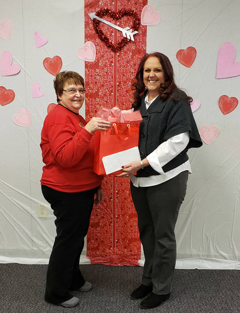 Diane Wills of Greenville (left) accepts week one prizes from Daily Advocate representative Candy Helm for The Daily Advocate's Red Hot Valentine's Day Contest. Wills won a $50 gift card to the Jewelry Barn in Versailles, a bag full of products valued at $50 sponsored at Merle Norman and a $50 gift card to El Camino Real.