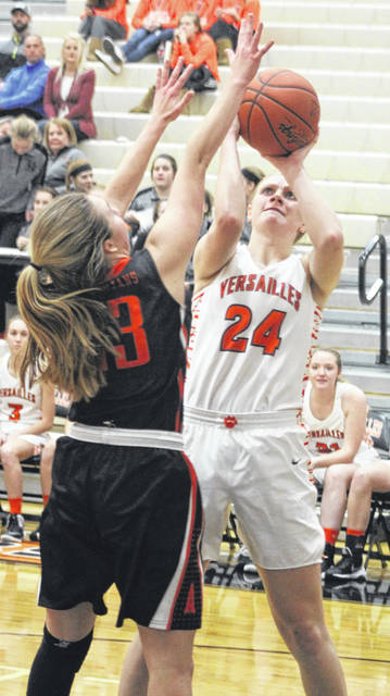 Versailles senior Elizabeth Ording puts up a shot against Arcanum's Gracie Garno during their non-league game on Tuesday night in Versailles. The Lady Tigers won the game, 48-33.