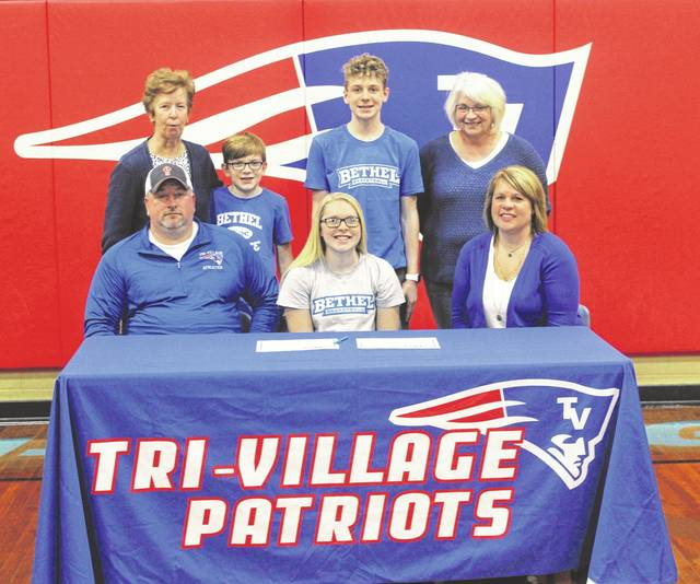 Tri-Village senior Emma Printz signed her letter of intent on Thursday to continue playing basketball at Bethel College in Mishawaka, Ind. Printz (seated center) is pictured with her parents (front row left to right) Travis and Jaimi Printz and (back row left to right) grandmother Tina Printz, brothers Weston and Tanner Printz and grandmother Mary Boone.