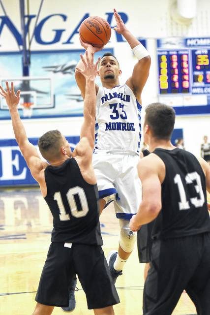 Franklin-Monroe senior Ethan Conley (33) has been named the Cross County Conference Player of the Year in boys basketball.