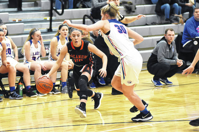 Arcanum freshman Madelyn Fearon drives around a Jamestown Greeneview defender during their Division III sectional tournament game on Wednesday at Covington. The Trojans advanced to the semifinals with a 60-42 win.