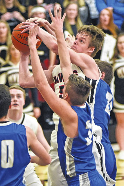 Mississinawa Valley's Will Hall goes up for a score draped by several Miami East defenders on Senior night Friday. The Blackhawks defeated the Vikings, 55-29.