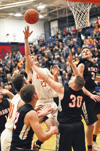 Ansonia's Hunter Muir goes in for a score during a Division IV sectional tournament game against Mississinawa Valley on Friday. Muir scored the 1,000th point of his career during the game which Ansonia won 38-35.
