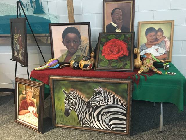 Local artist Linda Hamilton's fine art display is shown on Wednesday evening at the Edison State Community College Black History Month event.