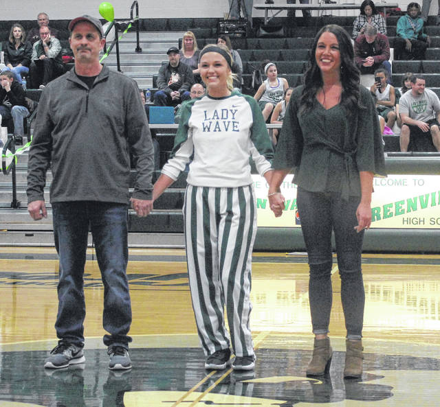 Greenville senior Jada Garland (center) is pictured with her parents Shannon Burns and Clyde Garland during a Senior Night celebration on Monday.