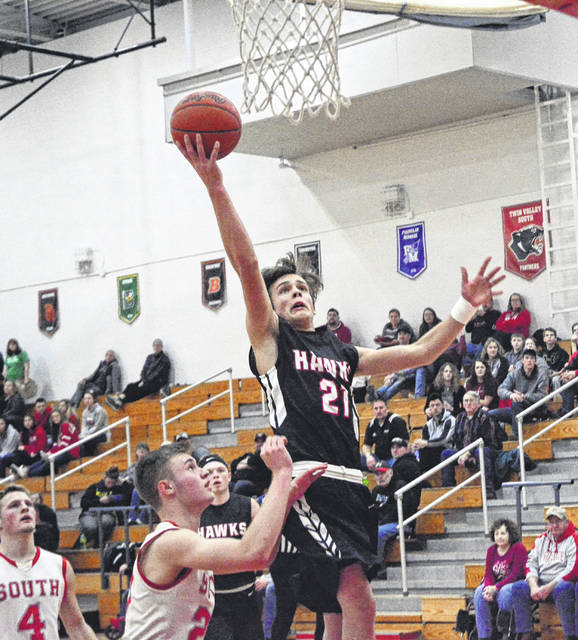Mississinawa Valley's Justin Miller flies in for a layup against Cross County Conference host Twin Valley South on Friday night. The Panthers won the game, 74-42.