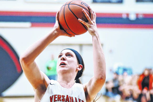 Versailles junior Lindsey Winner takes a mid-range jump shot during a Division III sectional game against Anna on Monday at Covington. The Lady Tigers won the sectional championship by defeating the Rockets 48-26.