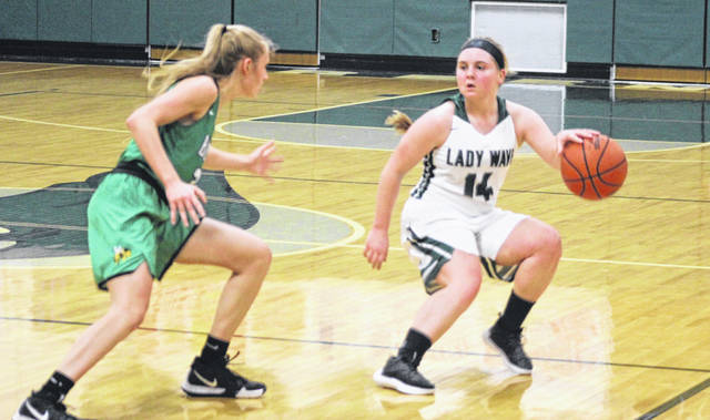Greenville point guard Morgan Gilbert gets the ball across the half-court line during first half action of a non-league game against Bethel on Monday. The Lady Wave celebrated Senior Night with a 49-38 win over the Bees.