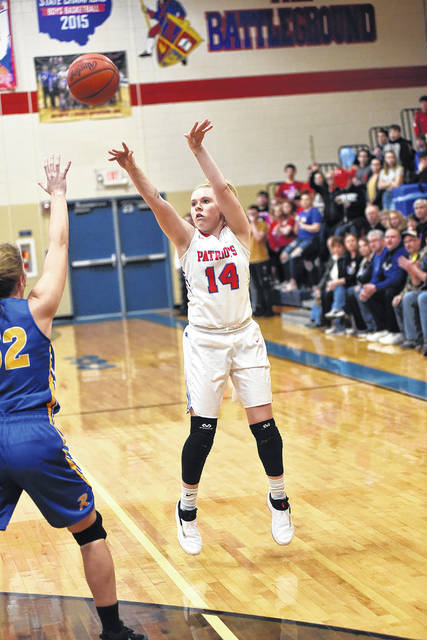 Tri-Village senior Emma Printz shoots a 3-pointer during her final game at the Battleground on Thursday. The Patriots defeated Russia, 45-33.