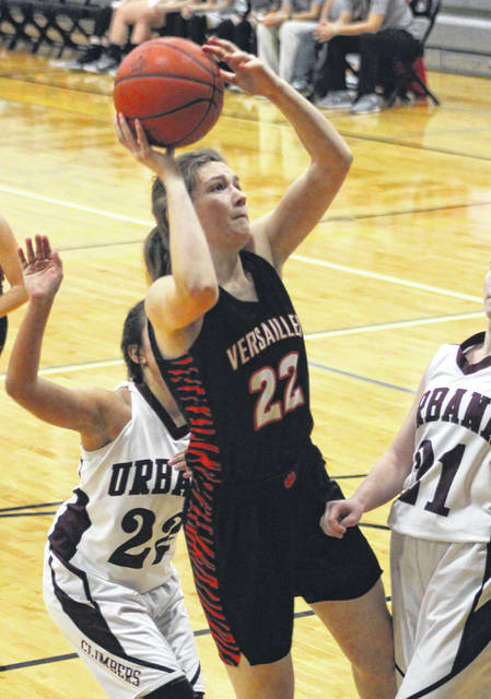 Versailles' Savannah Toner puts up a shot after getting her own rebound in the second half of a Division III sectional tournament game against Urbana on Thursday at Covington. The Lady Tigers won the game, 70-21.