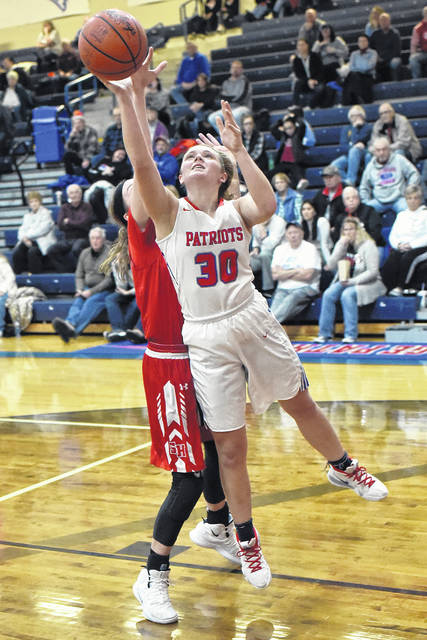 Tri-Village junior Lissa Siler goes in for a score in a game against St. Henry earlier this season. The Lady Patriots are ranked No. 3 in the final Division IV state girls basketball poll.