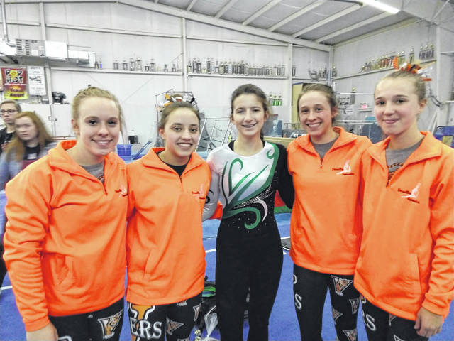 The Versailles gymnastics team placed second overall at the Troy Quad meet on Saturday, Feb. 9. Pictured left to right are Madison Ahrens, Ellie Barga, Greenville's Emily Marchal, Jadyn Barga and Jayla Pothast.