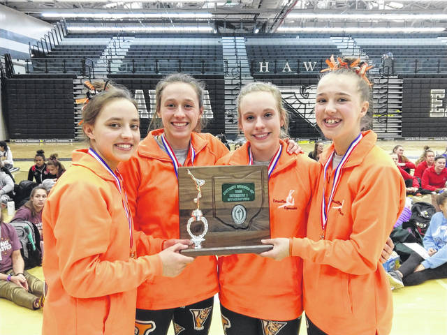 The Versailles gymnastics teams finished as runner-up in the district tournament at Lakota East this past Saturday. By placing second overall, the Tigers advance to the state meet as a team for the second time in their history. Pictured left to riht are team members Ellie Barga, Jadyn Barga, Madison Ahrens and Jayla Pothast.