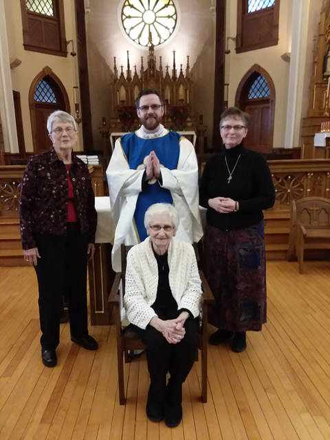 The Rev. Alex Witt is pictured with seamstresses Mary Honigford and Kathy Homan. Seated is Doris Ann Will. Not pictured are Jerry Will and McKenna Gels.