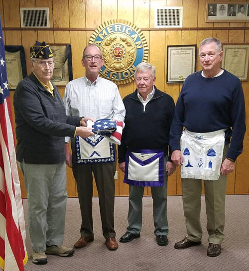 Ken Price, commander of the Greenville American Legion Post 140, presents an American Flag to Greenville Masonic Lodge No. 143. Pictured (l-r) are Price; John Dutro, worshipful master, Greenville Lodge 143; Larry Ullery, past district deputy grand master, 3rd Masonic District; and Chris Rehmert, marshal, Greenville Lodge 143 and commissioner for the Darke County Veterans.
