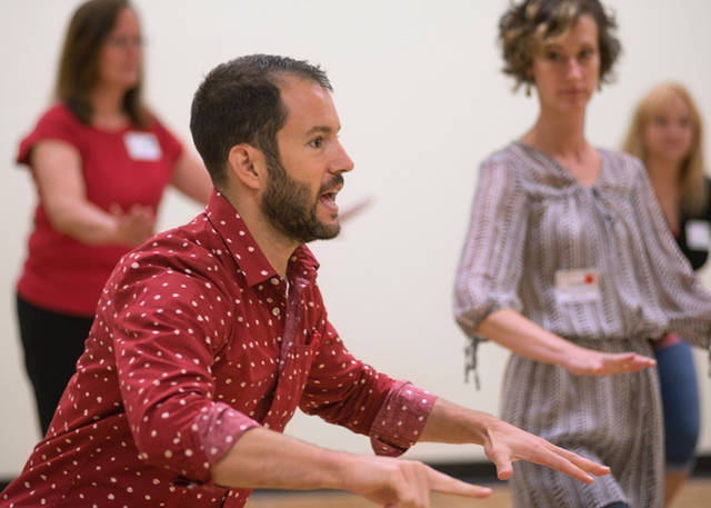 Teaching artist Ryan Conarro of Ping Chong + Company works alongside Muse Machine teachers.