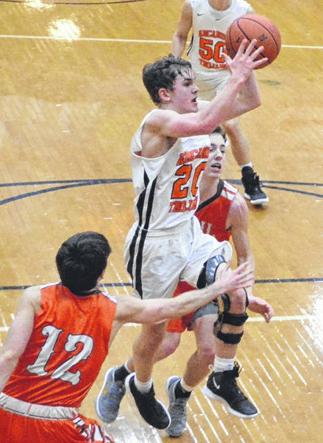 Arcanum's Wade Meeks goes into the paint for a shot against National Trail on Tuesday night in a Division III sectional semifinal contest at Vandalia Butler. The Blazers won the game, 56-38.