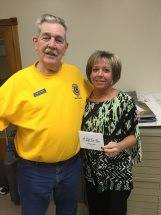Carrie Adams, winner of a gift certificate through a Union City Lions Club drawing, is pictured with Lion Hoddy Speight.