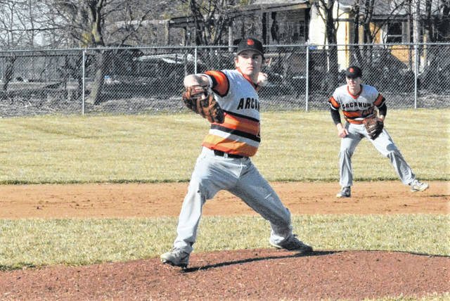 Arcanum senior Wave Meeks pitches the Arcanum Trojans 10 a 13-1 win over National Trail.