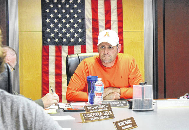 Arcanum Mayor Greg Baumle listens to village residents speak out on allegations against Arcanum Police Chief Andrew Ashbaugh. The village has placed Ashbaugh on paid administrative leave pending an investigation by the Darke County Sheriff's Office.