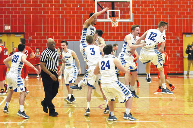 The Franklin-Monroe boys basketball players celebrate after coming from behind to defeat Newton 58-52 on Friday in a Division IV sectional final at Troy.
