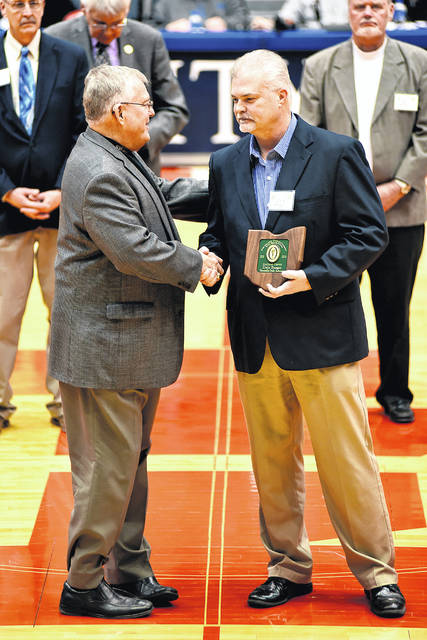 Dale Barger award recognition presented by OHSAA representative Bob Huelsman and Barger's former Covington High School basketball coach. (Evan Barger photo)